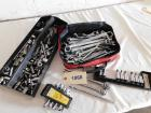 Assorted hand tools, mostly sockets and wrenches