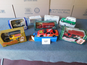 8 die-cast banks, 2 Coca Cola, 1 Nascar, 3 panel delivery vans, 1 us mail and 1 tractor trailer