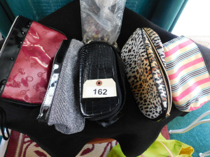 5 make up bags with bag of assorted bracelet charms