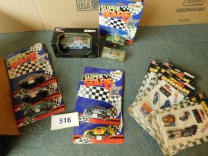 box of assorted nascar, including stickers, stock cars, racing champions