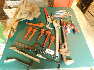 Misc tools, tool belt, oil filter, wrench on table only-shed