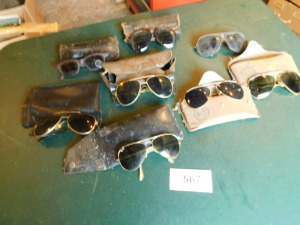 8 pair of sunglasses, 4 pair of Ray Bans table only-shed
