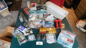 misc items on table, including plastic, screws, brackets, combination locks- shed