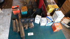 misc automotive, gauges, oil filters, exhaust, brake shoes, on table only- shed