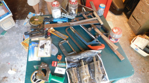 Misc hand tools, saws, hammer, glue gun, vise grips and more, table only-shed