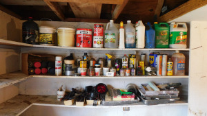 3 shelves of misc painting supplies, trailer lights, automotive oils and lubes, craftsman bar and chain lube, grass and weed killer and more-shed top 3 shelves left side