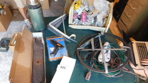 misc door hardware, extension cords, glue gun, stanley thermos, shelving brackets, old lawnmower blades, table only-shed