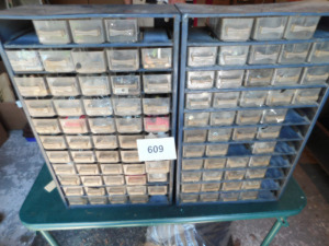 2 assorted organizer bins of screws, nuts, bolts, and more table only- shed
