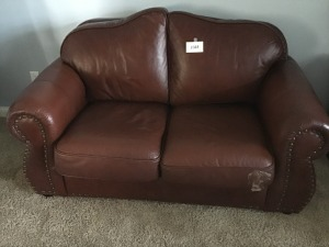 Faux Leather Love Seat, Slight Damage On Seat Cushion