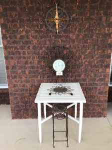 Outdoor Wall Art, White Metal Table And Metal Plant Stand