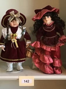 Two Porcelain Victorian Dressed Dolls