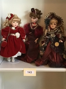 Three Porcelain Victorian Dressed Dolls