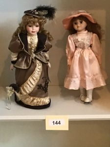 Two Porcelain Dolls - One Victorian Dressed And One Party Dressed