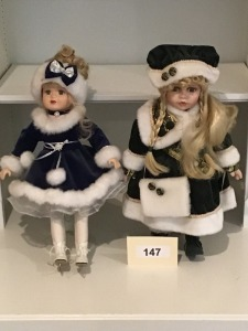 "Two Porcelain Winter Dressed Dolls, One A Collectible Memories ""Rebecca"""